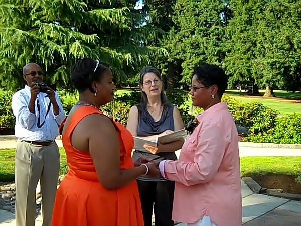 1420502938567 Carrietammiexchangingringsvows Vancouver wedding officiant