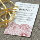 A long menu card featuring a rustic floral design.