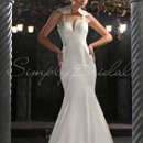 80181 The Brienne gown is truly one of a kind. This dramatic mermaid dress has a unique halter back detail. This dress looks equally wonderful from all angles.