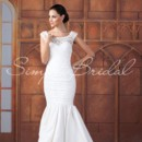 Trinity Gown - 80376  The Trinity gown is absolutely gorgeous from the front and back. The entire gown is made of beautiful taffeta and lace and hugs every curve on the body. Delicate cap sleeves add a soft and delicate detail.