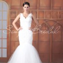 Carla Gown - 80395  The Carla gown is an unforgettable and sexy look. The scalloped neckline is all lace and flows down to a full tulle skirt for extra drama. This figure hugging gown is perfect for a confident bride who isn't afraid to be the center of attention.