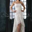 Myra Gown - 80407  Not every woman can rock an asymmetrical gown. This mermaid sheath gown is short in the front but has a court train in the back. The strapless dress has a straight neckline, and a hi-low skirt. A corset-back is one of the few classic wedding touches.