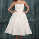 Abbey Gown - 80413  This strapless sweetheart tea length dress is playful, but the stiff and glossy taffeta is sophisticated. The pleated bodice is accented with a waist waistband. The A-line gown is fitted along the waist before flaring out into a wide skirt.