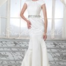 Ilene Gown - 80330  The Ilene gown is lovely and refined. Simple pleating along the jewel neckline add soft detailing to the trumpet silhouette. A beaded waistband adds a luxurious touch and helps accentuate the waistline.