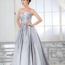 Sally Gown - 80336  The Sally gown is the picture of elegance. The flattering sweetheart neckline is beautifully pleated and the fitted bodice is adorned with a fabulous rhinestone belt. The flattering corset back and overall lines of the dress make this a great choice.