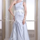 Beatrice Gown - 80339  The sash on this dress is removable.The Beatrice gown. Simply chic best describes this satin demarcated trumpet style. The entire bodice is ruched perfectly and a one shoulder neckline adds a modern touch.