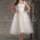 Cheryl Gown - 80338  This tea length A-line gown is a romantic mix of lace, satin, and tulle. The lace bodice is accented with a wide satin waistband, creating an illusion of a slimmer waist. The skirt is made of flowing tulle and will ripple playfully in the breeze.