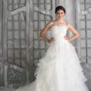 Savannah Gown - 80247  The Savannah is a dreamy fairytale gown. Light and airy organza is ruched and tiered perfectly to create a romantic and ethereal look that is sure to turn heads.