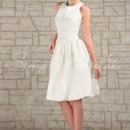 Karen Gown - 80124  The Karen gown is a short sleeveless ball gown. The delicate ruching of the skirt and jewel neckline give this dress a deceptively simple appearance, but the unusual cut of the back flatters the shoulders and arms.