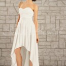 Morgan Gown - 80151  The Morgan gown is for a bride who likes a little drama. Knee length in the front but full length in the back, this edgy gown is softened with a sweetheart neckline and elegant satin material.