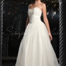 Chelsea Gown - 80178  The Chelsea gown is a modern and glamorous ball gown. The bodice is encrusted with floral beading and eye-catching while the full organza skirt is both comfortable and beautiful.