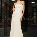 Rhiannon Gown - 80179  The Rhiannon gown is a sleek and sensual gown that wouldn't look out of place on the red carpet. Strikingly simple and expertly tailored, this hip hugging sheath gown is gorgeous choice for any wedding occasion.