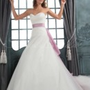 Penelope Gown - 80007  The iconic gown for the princess bride. This A-line silhouette features a sweetheart neckline, strapless bodice and a lilac sash. Ivory tulle and taffeta will bloom and billow from your radiant self.