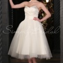 Marie Gown - 80461 This ballerina-style tea length ball gown has modern and vintage elements. The length has a 1950s vibe, but the playful yet sophisticated mix of satin and dotted tulle is thoroughly modern.