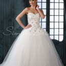 Valencia Gown - 80409 Every once in a while, there is a gown that just takes your breath away! This strapless gown has an elaborately embroidered and beaded bodice and a full tulle A-line skirt. The dipped neckline, chapel train, and corset back are familiar wedding dress elements.