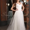 Crystal Gown - 80447 Have your cake and eat it too with this mermaid A-line wedding dress. The mermaid silhouette is made in chiffon with an overlay of tulle for a figure-hugging number that also billows in the wind. This floor length gown also has a chapel train.