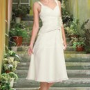 Hillary Gown - 80233 The tea-length Hillary gown channels traditional beauty. The ruched bodice and simple A-line silhouette flatters almost all figures, while the floral applique adds a simple point of interest.