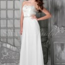 Cassandra Gown - 80198 The Cassandra is an ultra feminine sheath gown made with delicate chiffon and gorgeous beaded lace at the bodice. A dipped neckline and pleating along the bodice add flattering touches to the bodice while rich beading at the waist add sophistication.