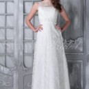 Doris Gown - 80196 The Doris is a classic,lady like satin and lace gown. Its sheath silhouette accentuates curves while the beaded waistband adds sparkle and definition. This is a perfect option for elegant indoor weddings yet simple enough for outdoor and garden ceremonies.