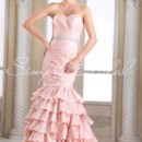 Ariel Gown - 80337 The Ariel gown is for a woman who isn't afraid to show off her curves. Luxurious taffeta is ruched perfectly along the bodice down to an incredible ruffled skirt. The waist is perfectly accentuated with a rhinestone belt.