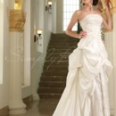Victoria Gown - 80074 Lush and luxurious, this ivory satin ball gown is a stand-alone stunner. The strapless bodice is intensely adorned with silver, floral embroidery and beading, and the straight neckline is bordered with twinkling beads.