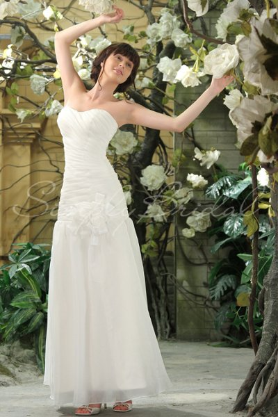 80002	 The Lauren gown is a romantic trumpet silhouette with a large flower perched right below the waist. This ivory organza dress features a heavenly sweetheart neckline and gently ruched strapless bodice. The soft and airy skirt flares below the waist and flutters perfectly to the floor. Designed with brush train and back zipper.