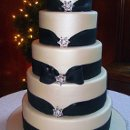 130x130 sq 1340582524859 blackweddingcakeaminuts