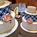 130x130 sq 1394738078354 navy geometric design on oval cake with sugar peon