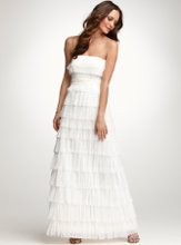 "Fringe Wedding Gown Style No. 256378 A floaty, exquisite strapless gown composed of ethereal, delicate fringed tiers. Front pleating at empire waist sash. Hidden centerback zip with hook-and-eye closure. Fully lined. 45"" length from natural waist."
