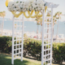 A floral bedecked altar draped with white and yellow blossoms