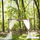 The classic rustic-romantic wedding backdrop, studded with purple flowers.