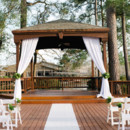 A rustic backdrop in a woodsy setting