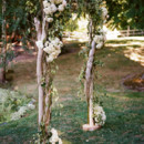 Tree branches and hydrangeas are rustic and romantic