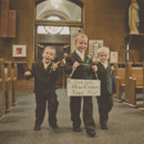 A trio of silly ring bearers walk down the aisle.