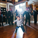 A ring bearer lets loose on the dance floor!