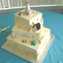 "Square Bride catching the Groom ""fishing theme"" wedding cake. Gumpaste tarpon, snook, redfish and sea turtle. Beach theme."