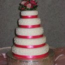 130x130 sq 1319897375857 weddingcakewithredribbonsandfondantwithbuttercream