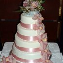 130x130 sq 1319897458038 weddingcakepinkribbonswithorchids