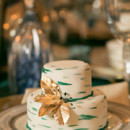 Elegant emerald and gold wedding cake.