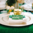 Emerald and gold place setting.