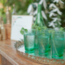 Minty beverages served in emerald green glassware.