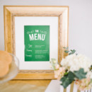 Emerald green menu card displayed in gilded gold frame.