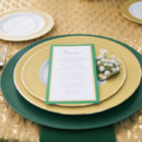 Glamorous emerald green and gold place setting.