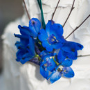 Sapphire blue floral cake accent.