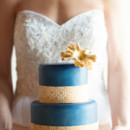 Modern blue and gold wedding cake.
