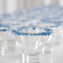 Winter wedding cocktail glasses with dark blue sugar rims.
