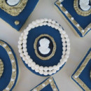 Blue, gold, and pearl white sugar cookies featuring victorian silhouettes.
