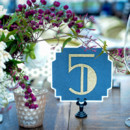Sparkly blue and gold art deco table number.