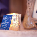 Dark blue stationery and silver mercury votive.
