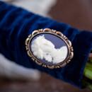 Dark blue velvet bridal bouquet wrap and vintage brooch.
